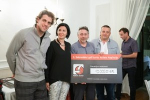 One of the recipients with Anze Kopitar - pro hockey player, Tanja Skaza - President of Red Ball foundation and Joc Pececnik - chairman of Interblock